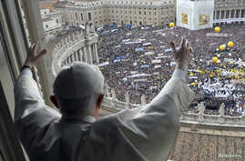 Pope Benedict waves to the crowd gathered in Saint Peter's square during his weekly Angelus blessing at the Vatican, May 16, 2010.