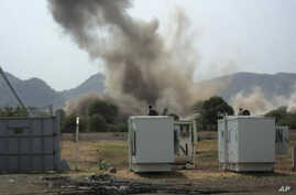 A hugh explosion near a United Nations compound in South Kordofan state, Tuesday, June 14, 2011