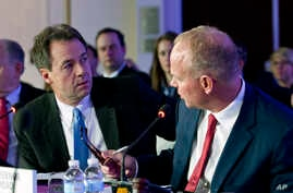 Gov. Steve Bullock of Montana speaks with Gov. Matt Mead of Wyoming during the National Governor Association 2018 winter meeting, Feb. 24, 2018, in Washington.
