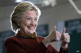 Democratic presidential candidate Hillary Clinton gestures at supporters during a campaign event at the Taylor Allderdice High School, Oct. 22, 2016, in Pittsburgh, Pa.