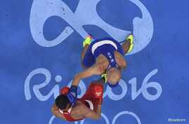 Evgeny Tishchenko of Russia and Vassiliy Levit of Kazakhstan compete in heavyweight boxing in Rio de Janeiro, Aug. 15, 2016.