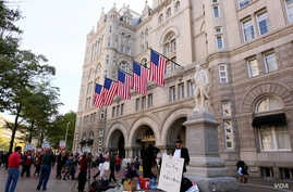 Hundreds protested Donald Trump at the opening of the International Trump Hotel at the Old U.S. Post Office Building in Washington, D.C. Trump was in town for the ribbon-cutting for the luxury hotel, less than two weeks before election day. October 2