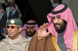 Saudi Arabia's Crown Prince Mohammed bin Salman gestures during the graduation ceremony of the 93rd batch of the cadets of King Faisal Air Academy, in Riyadh, Feb. 21, 2018.