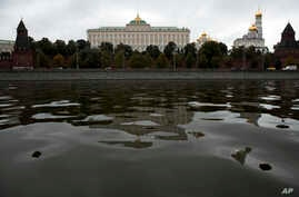 The Kremlin with its palaces and churches is reflected in the Moskva River waters in Moscow, Russia, Sept. 30, 2016. Russia has entered a second year of its military operation in Syria.