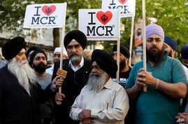 Members of the Manchester Sikh Community attend a vigil in Albert Square, Manchester, England, May 23, 2017, the day after the suicide attack at an Ariana Grande concert that left 22 people dead as it ended on Monday night.