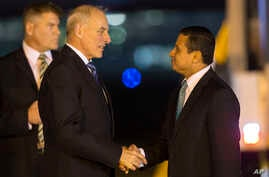 Guatemala's Foreign Minister Carlos Morales, right, receives U.S. Secretary of Homeland Security John F. Kelly, at La Aurora Air Force Base, in Guatemala City, Feb. 21, 2017.