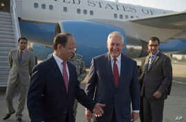 U.S. Secretary of State Rex Tillerson chats with Pakistani foreign office official, Sajid Bilal, as he arrives to the Nur Khan military airbase in Islamabad, Pakistan, Oct. 24, 2017.