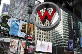 FILE - The logo for the W Hotel, owned by Starwood Hotels & Resorts Worldwide, in New York's Times Square,  July 31, 2013. The information of as many as 500 million guests at Starwood hotels has been compromised.