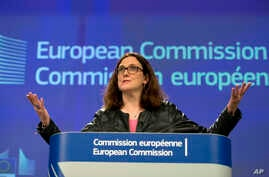 European Commissioner for Trade Cecilia Malmstroem speaks during a media conference at EU headquarters in Brussels on Wednesday, March 7, 2018. The European Union will set out its strategy Wednesday on how to counter potential U.S. punitive tariffs o