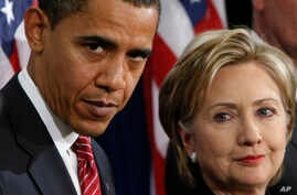 FILE - In this Dec. 1, 2008, file photo, then-President-elect Barack Obama, left, stands with then-Sen. Hillary Rodham Clinton, D-N.Y., after announcing that she is his choice as Secretary of State during a news conference in Chicago.