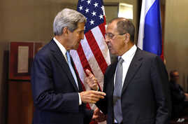 U.S. Secretary of State John Kerry, left, and Russian Foreign Minister Sergei Lavrov shake hands after conducting a bilateral meeting during the 68th session of the United Nations General Assembly at U.N. headquarters, Sept. 24, 2013.