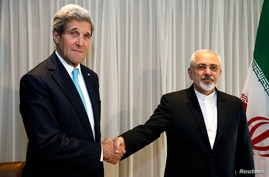 U.S. Secretary of State John Kerry shakes hands with Iranian Foreign Minister Mohammad Javad Zarif before a meeting in Geneva, Jan. 14, 2015.