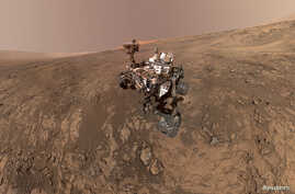 FILE - NASA's Curiosity Mars Rover snaps a self-portrait at a site called Vera Rubin Ridge on the Martian surface in Feb. 2018 in this image obtained on June 7, 2018.