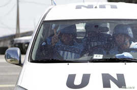 Filipino United Nations peacekeepers drive at the Kuneitra border crossing between Israel and Syria, in the Israeli occupied Golan Heights March 9, 2013.