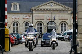 Policemen escort the vehicle transporting Mehdi Nemmouche, the Frenchman suspected in the shooting deaths of three people at the Brussels Jewish Museum, as he leaves the Appeal Court of Versailles, outside Paris, France, June 5, 2014.