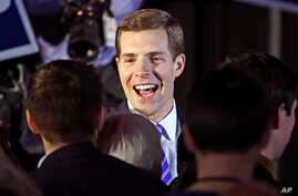Conor Lamb, the Democratic candidate for the March 13 special election in Pennsylvania's 18th Congressional District, center, celebrates with his supporters at his election night party in Canonsburg, Pa., early March 14, 2018.