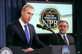 Deputy Defense Secretary Patrick Shanahan, left, speaks next to Deputy Energy Secretary Dan Brouillette, during a news conference on the 2018 Nuclear Posture Review at the Pentagon, Feb. 2, 2018.