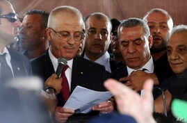 Palestinian Prime Minister Rami Hamdallah speaks during a press conference on his arrival to the Palestinian side of the Beit Hanoun border crossing in the northern Gaza Strip, Oct. 2, 2017.