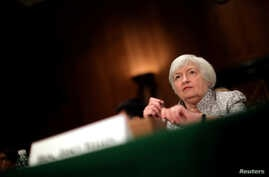 FILE - Federal Reserve Chair Janet Yellen testifies before a Senate Banking Committee hearing on the 'Semiannual Monetary Policy Report to the Congress' on Capitol Hill in Washington, July 13, 2017.