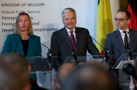 European Union foreign policy chief Federica Mogherini (L), speaks during a media conference with EU members of the UN Security Council Belgian Foreign Minister Didier Reynders (C), and German Foreign Minister Heiko Maas (R) at the Egmont Palace in B