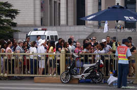 Visitors queue for a security check to enter Tiananmen Square in Beijing, June 4, 2014.
