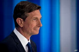 President incumbent Borut Pahor looks at his counter-candidates ahead of a televised debate at Slovenia's public TV, in Ljubljana, Slovenia, Oct. 19, 2017. Slovenia, the Alpine home country of Melania Trump, is holding a presidential election Sunday