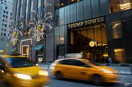 Traffic passes Trump Tower in New York, Nov. 21, 2016.