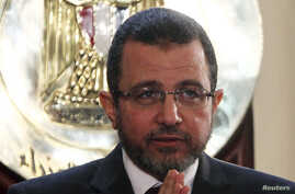 Egyptian Prime Minister Hisham Kandil speaks during a news conference in Cairo, December 30, 2012.