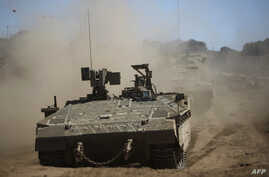 Israeli soldiers manuever a tank during a military exercise in the northern part of the Israeli-annexed Golan Heights on September 7, 2017. Syria said Israeli airstrikes hit a facility in the country's west where the Syrian regime has been accused of