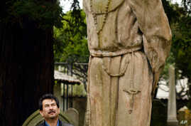 A statue of Father Junipero Serra stands in the cemetery of Mission Dolores in San Francisco.