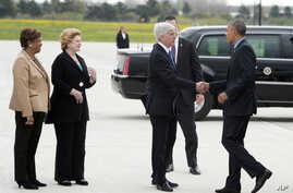 U.S. Rep.Brenda Lawrence, U.S. Sen. Debbie Stabenow, and Gov. Rick Snyder greet President Obama as he arrives at the Bishop International Airport in Air Force One for a visit to Northwestern High School in Flint, Mich.,  May 4, 2016.