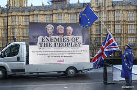 Anti-Brexit protesters demonstrate outside the Houses of Parliament in London, Britain, Dec. 13, 2017.