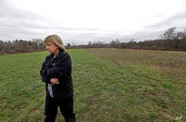In this April 12, 2016 photo, Desiree Moninski, walks on land located across from her house in Dudley, Mass., which is the site of a proposed Muslim cemetery, a project vigorously opposed by area residents. Regarding the land once farmed by her grand