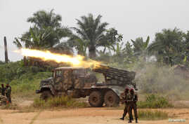 FILE - Democratic Republic of Congo soldiers launch missiles during a military operation against ADF rebels outside the town of Beni, in North Kivu province, Jan. 18, 2014.