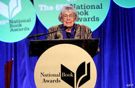 FILE - Fantasy author Ursula K. Le Guin speaks at the 2014 National Book Awards in New York, Nov. 19, 2014.