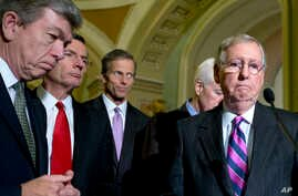 From left, Sen. Roy Blunt, R-Mo., Sen. John Barrasso, R-Wyo., Sen. John Thune, R-S.D., Senate Minority Whip John Cornyn of Texas, and Senate Minority Leader Mitch McConnell R-Ky., pause during a news conference on Capitol Hill in Washington, Nov. 18,
