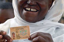 Diawara Aissata displays her newly-acquired national identity card and voter ID in the Plateau neighborhood of Abidjan, Ivory Coast (File)
