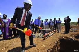 The governor of Baringo County, Benjamin Cheboi, was joined by USAID associate administrator Mark Feierstein in breaking ground for a new power plant in Kenya. (Courtesy USAID)