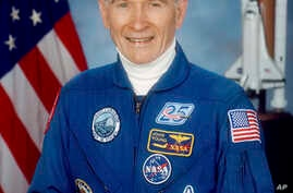This undated photo made available by NASA shows astronaut John Young. NASA says the retired astronaut died Jan. 5, 2018, at age 87.