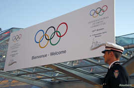A Monaco policeman stands in front of the Grimaldi Forum during the opening of the 127th International Olympic Committee (IOC) session in Monaco, Dec. 8, 2014.