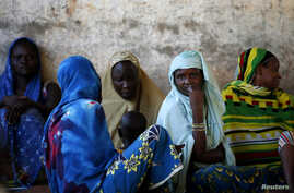 Internally displaced women from Bangui attend a community meeting in Bambari, Central African Republic, June 16, 2014.