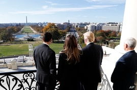House Speaker Paul Ryan of Wis., left, shows President-elect Donald Trump, his wife Melania and Vice president-elect Mike Pence the view of the inaugural stand that is being built and Pennsylvania Avenue, from the Speaker's Balcony on Capitol Hill in
