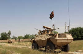 FILE - A military vehicle patrols in the Babaji area of Lashkar Gah Helmand province, Afghanistan, May 8, 2016.