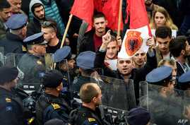 Kosovo Albanians waving Albanian national flags take part in a demonstration in Pristina, Nov. 3, 2017, to protest against the verdict of the Macedonian court that sentenced an eighth ethnic Albanian man to life in prison over a 2015 shootout with po