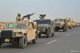Egyptian Army armored vehicles are seen on a highway traveling toward north Sinai during a launch of a major assault against militants, in Ismailia, Egypt, in this undated handout picture made available by Egypt's Ministry of Defense Feb. 9, 2018.