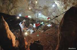 Researchers work inside Manot Cave in Israel's Western Galilee in this picture released Jan. 28, 2015.