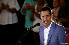 Venezuelan opposition leader Juan Guaido, who many nations have recognized as the country's rightful interim ruler, attends a rally against Venezuelan President Nicolas Maduro's government in Caracas, Venezuela, March 14, 2019.