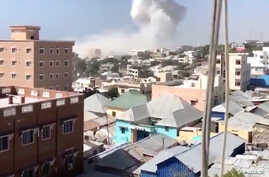 Smoke rises after an explosion in Mogadishu, Somalia, Dec. 22, 2018, in this still image taken from social media video.