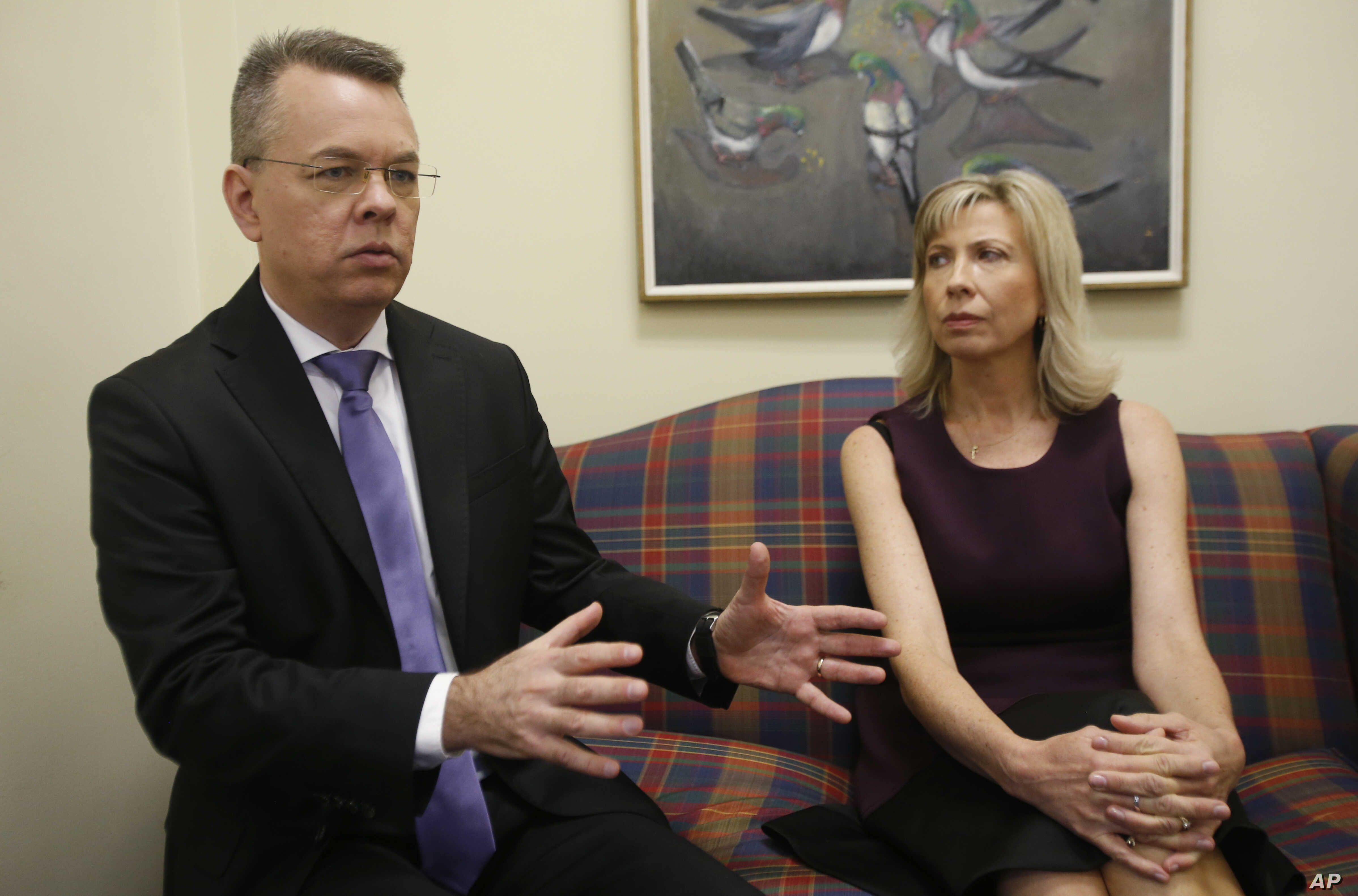 Pastor Andrew Brunson, left, gestures as his wife, Norine, listens during an interview at the headquarters of Christian Broadcasting Network in Virginia Beach, Va., Oct. 19, 2018. Brunson was recently released from prison in Turkey.