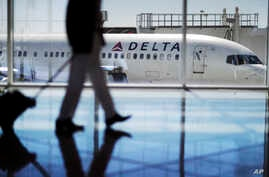 FILE - A Delta Air Lines jet sits at a gate at Hartsfield-Jackson Atlanta International Airport in Atlanta, Oct. 13, 2016. Georgia lawmakers punished Atlanta-based Delta Air Lines, March 1, 2018, for its decision to cut business ties with the Nationa...